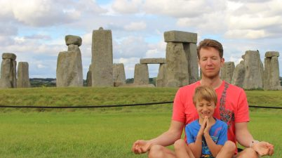 Simon and Jay meditating at Stonehenge - from AnAccidentalAnarchist.com